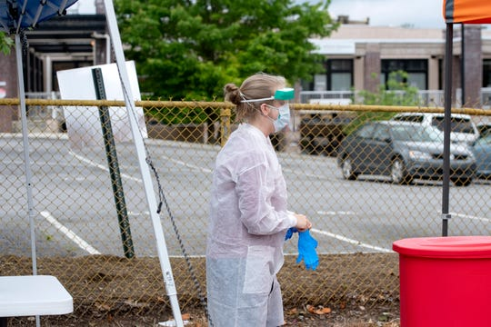 Medical and emergency response officials set up a Buncombe County COVID-19 testing site on Coxe Avenue downtown on May 26, 2020.