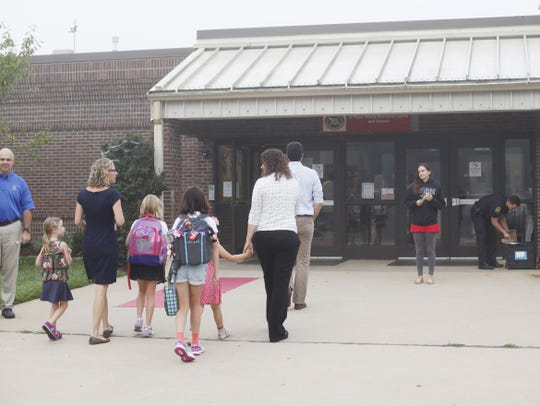 Parents dropped their children off for their first day of school at Vance Elementary in West Asheville August 29, 2016.