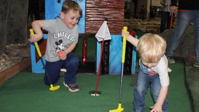 Asheville's Fun Depot announced July 20 it will close in August after a 17-year run, an outcome caused by the COVID-19 pandemic and sluggish economy. In this file photo, kids golf, climb, play games and more at a birthday party at Asheville's Fun Depot.
