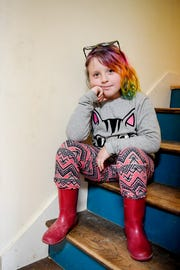 Emma Smith, 8, sits on a staircase in her home in Arden January 17, 2020.